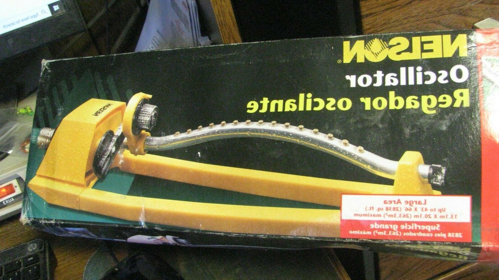 yellow oscillating lawn garden sprinkler 1025 2800