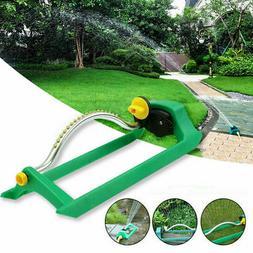 oscillating water sprinkler watering outdoor lawn irrigation